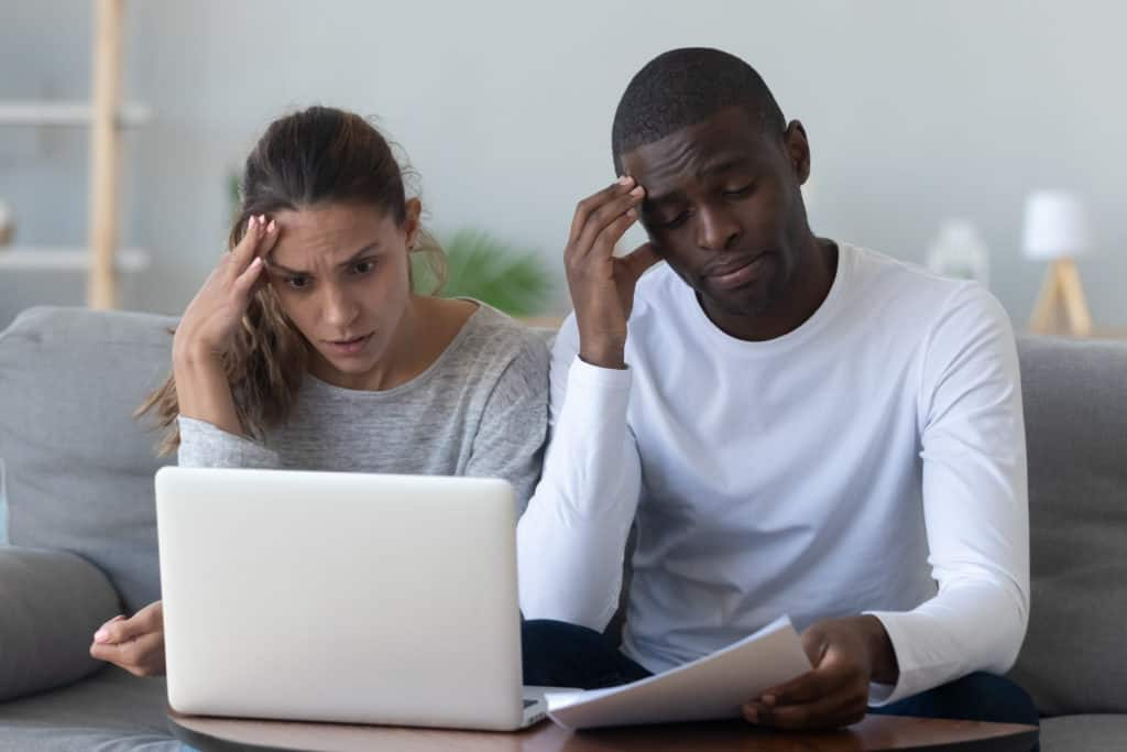 couple stressed because they need cash for an emergency - reasons to sell your house fast in new jersey