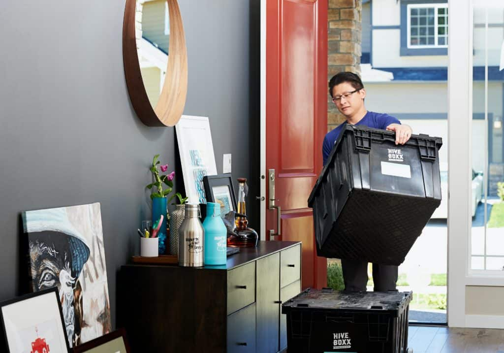 man packing up to move to relocate for new job - reasons to sell your house fast in new jersey