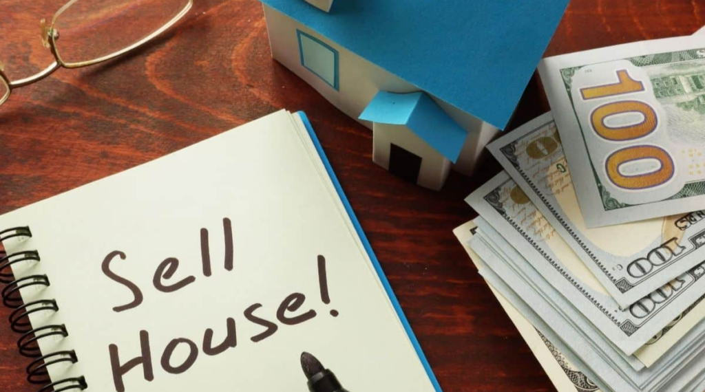 Top 7 Reasons To Sell Your House Fast In New Jersey Blog Post Cover - cash with house and notebook on table