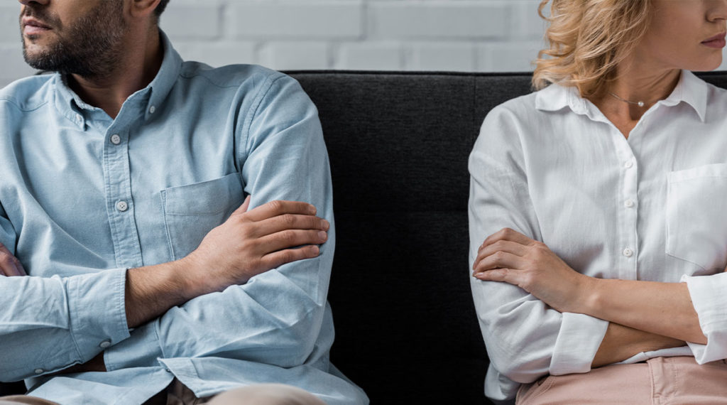 Photo of a couple estranged and facing away for the blog post how to sell a house during a divorce - quick home buyers nj