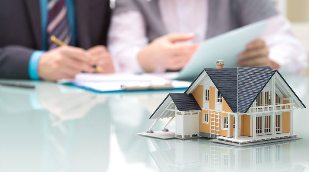 People signing real estate contract for selling an investment property in New Jersey for cash - Quick Home Buyers NJ